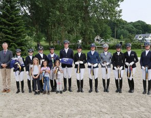 Judge, Torleif Siegel congratulates winners Eva Möller and Lars Ligus as well as the other placed riders in the Bundeschampionat Qualification for five-year-old dressage horses.