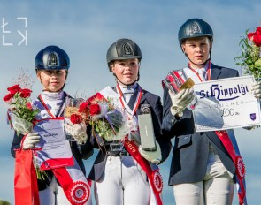 Natalia Plata, Taja Zoll, Dionizy Polikowski make the children's podium at the 2019 Polish Dressage Championships :: Photo © Lukasz Kowalski