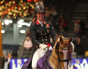 Charlotte Dujardin in her lap of honour on her rising GP horse Gio at the 2019 CDI-W London :: Photo © Astrid Appels