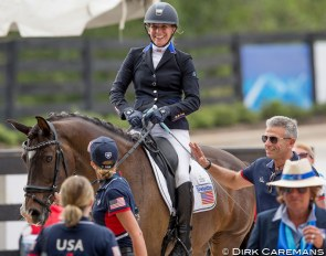 U.S. Para team trainer Michel Assouline patting Rebecca Hart on the leg after winning bronze at the 2018 World Equestrian Games in Tryon :: Photo © Sharon Vandeput