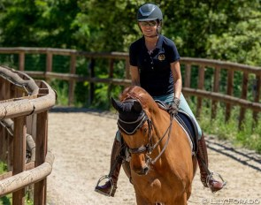 Beatriz Ferrer-Salat back in the saddle and here on the canter track with Rosini at her Villa Equus in Barcelona :: Photo © Lily Forado