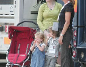 Anky van Grunsven with her children and the nanny watching the warm up.