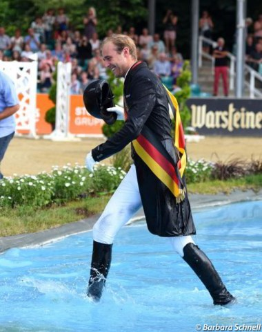 Traditionally the German champion gets thrown into the water jump