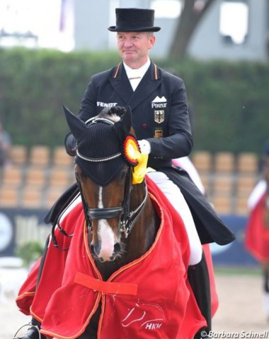 Hubertus Schmidt and Escorial win the Short Grand Prix