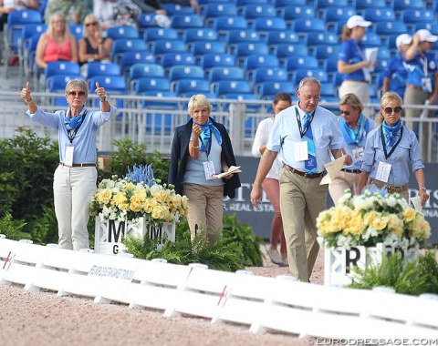 Judge Susan Hoevenaars gives a thumbs' up to indicate that all systems are go to begin the Grand Prix class after the guinea pig rode