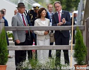 Show director Frank Kemperman gives a tour of the Aachen show grounds to Swedish king Carl XVI Gustaf and Queen Silvia