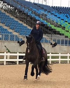Charlotte Dujardin and Valegro in a snaffle taking a relaxed canter around the show ring