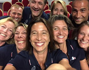 The French team and its officials take a selfie