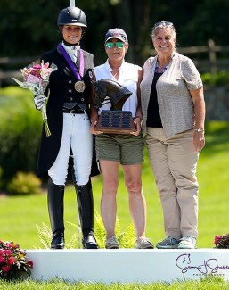 The Dressage Style Award and The Fiona Baan Memorial Trophy recipient Callie Jones with Roberta Williams (center), USDF FEI Junior and Young Rider Committee Chair, and Katherine Robertson, USDF Education Department Manager (right)  :: Photo © Sue Stickle
