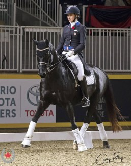 American Olympian, Adrienne Lyle expertly guided Daedalus, owned by Gail Tittley and trained successfully to the small tour level by Canadian Maya Markowski, to ultimately win the inaugural Canadian Dressage Derby at the Royal Horse Show :: Photo © Cealy Tetley