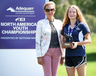 Judge Maja Stukelj handing the Dressage Style Award to Abby Fodor at the 2019 NAYC