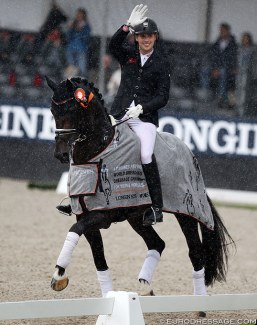 Frederic Wandres and Zucchero in a rainy lap of honour at the 2019 World Young Horse Championships :: Photo © Astrid Appels