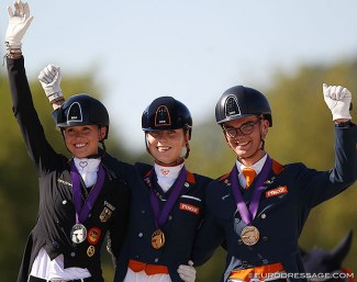 Lia Welschof, Daphne van Peperstraten, Marten Luiten on the Kur Podium at the 2020 European Young Riders Championships :: Photo © Astrid Appels